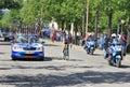 Giro d italia on streets of alba may cyclist between car and policeman motorcycle at famous international prestigious three week Royalty Free Stock Photos