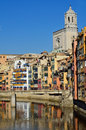 Girona spain colorful houses over onyar river with cathedral at the background in Royalty Free Stock Photography