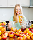 Gitl with fresh fruit beverage in glass at home kitchen Stock Photography