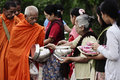 Give food offerings to a Buddhist monk Royalty Free Stock Photos