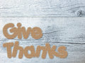 Give thanks thanksgiving greetings written with gingerbread letters on white wood background Royalty Free Stock Images