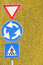 Give way and right arrow direction signs with ancient italian military accademy as background Royalty Free Stock Photo