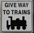 Give Way to Trains Sign Royalty Free Stock Photography