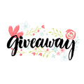 Giveaway banner. Brush lettering word and hand drawn flowers decoration. Royalty Free Stock Photo