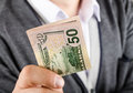 Gives fifty dollars businessman closeup Royalty Free Stock Photos