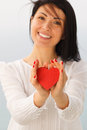 Giving heart female presenting a red Stock Photography