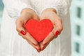 Giving heart female s hands presenting a red Royalty Free Stock Photo