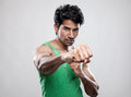 Giving a knockout punch handsome indian man Stock Image