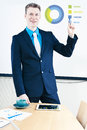 Giving presentation smiling businessman with infographic Royalty Free Stock Photography