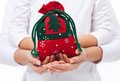 Giving presents to the loved ones at christmas concept with child and adult hands Royalty Free Stock Photography