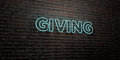 GIVING -Realistic Neon Sign on Brick Wall background - 3D rendered royalty free stock image