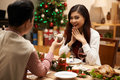 Giving small present man to his girlfriend at the christmas dinner Stock Images
