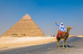 GIZA, EGYPT - September, 16, 2008: Camel rider and Pyramid of Kh Royalty Free Stock Photo