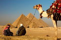 Giza pyramids in egypt with bedouins in foreground Stock Image