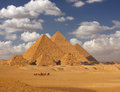 Giza pyramids in egypt with caravane in foreground Stock Image