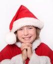 Glück-Mädchen in der Weihnachtsmütze Lizenzfreies Stockbild