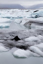Glacial ice jokulsarlon in drifting towards the sea in southern iceland Stock Photos