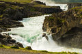 Glacial river with Godafoss waterfall in background, Iceland Royalty Free Stock Photo
