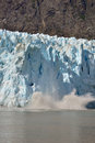 Glacier calving ice off a in alaska Stock Photo