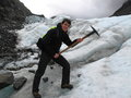 Glacier hike young man hiking on fox new zealand Royalty Free Stock Photo