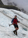 Glacier hike young man hiking on fox new zealand Stock Image