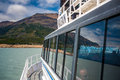 The glacier is reflected in the ship window. Shevelev. Royalty Free Stock Photo