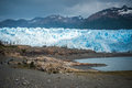 Glacier on the shore of the bay. Shevelev. Royalty Free Stock Photo