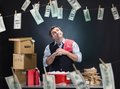 Glad businessman is laundering money banknotes in foam in red washbowl Royalty Free Stock Photography