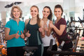 Glad females of different age training on exercise bikes Royalty Free Stock Photo