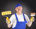 Glad house painter against black background Royalty Free Stock Image