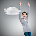 Glad pretty woman puts her hands up grey background with cloud Stock Photo