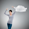 Glad pretty woman puts her hands up with two fingers pointed up isolated on grey background cloud Stock Photo