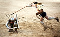 Gladiator dodges the trident merida spain – april performing of gladiators fighting of merida s amphitheater on april in merida Stock Photography