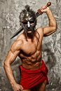 Gladiator with muscular body sword and helmet Stock Images