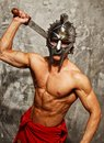 Gladiator with muscular body sword and helmet Stock Photography