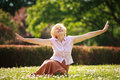 Gladness meditation mature pleased woman relaxing with outspread arms happy old in the park Stock Photos