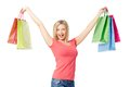 Gladness portrait of happy female raising arms with colorful paperbags over white background Stock Image