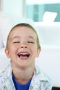 Gladness portrait of happy little boy laughing and looking at camera Stock Image