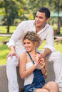Gladness vertical image of a glad young couple smiling and having fun in the park Stock Image