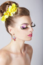Glam profile of fashionable woman with amazing fantastic eye make up glamorous fashion girl trendy makeup Royalty Free Stock Image