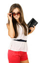 Glamor beautiful girl in sunglasses and clutches Royalty Free Stock Images