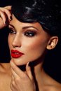 Glamor closeup portrait of beautiful sexy stylish brunette Caucasian young woman model with bright makeup, with red lips, with per Royalty Free Stock Photo