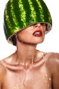 Glamor closeup portrait of beautiful sexy young woman model with water melon on head with water drops with red lips with perfect Stock Photos