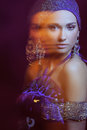 Glamor girl in beautiful jewelry in motion Royalty Free Stock Image