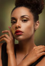 Glamorous african woman young gently touching her face Royalty Free Stock Photos