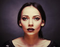 Glamorous beautiful woman face of an attractive with fashion makeup Royalty Free Stock Photos