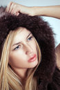 Glamorous blond woman fashion fur style attractive young model studio photoshoot Stock Images