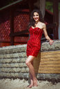 Glamorous curvy brunette in red stone dress with sexy body Royalty Free Stock Photo
