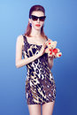 Glamorous lady girl in glasses loving teddy bear with red lips and dress with leopard print holds hands with red heart Stock Photos