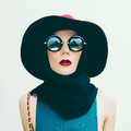 Glamorous lady in vintage hat and sunglasses trend. fashion port Royalty Free Stock Photo